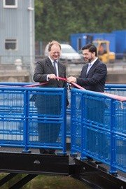 Secretary of State for Wales the Rt Hon Stephen Crabb is joined by Alec Don, Chief Executive of the Port of Milford Haven, as he cuts the ribbon on the new lock gates at Milford Marina and declares them officially open