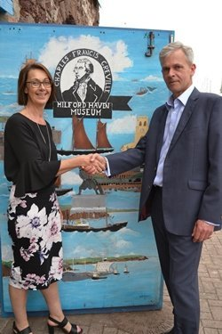 Clare Stowell from the Port of Milford Haven and Tim Ash from The National Museum of the Royal Navy celebrate the new collaboration