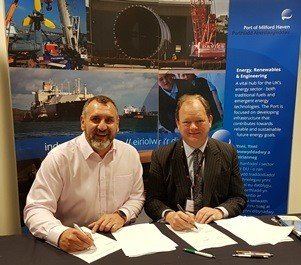 Simon Gillett, Chief Executive at Wave-tricity, and Alec Don, Chief Executive at the Port of Milford Haven, sign new deal which extends each business' commitment to marine renewable energy development in Pembrokeshire.