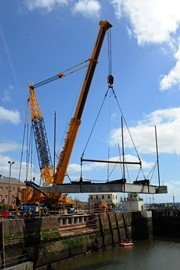 A 1,000 tonne crane lifts the sill into Milford Dock's new lock